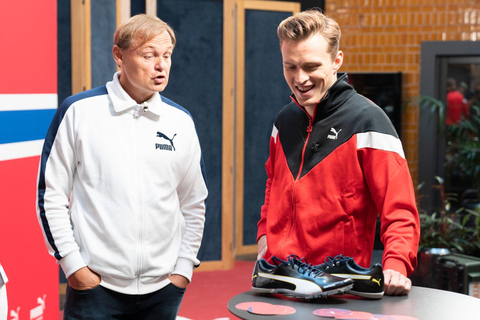 Puma-sjefen Bjørn Gulden og Karsten Warholm i samtale under pressemøtet.